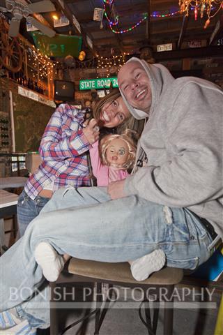 Shane sitting on Big Girls lap at the Tiki Bar