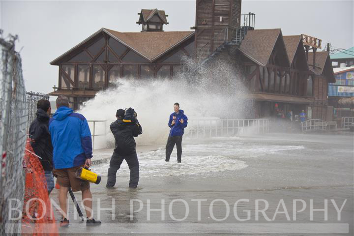 News Channels were all reporting live from Dock Street as the waves crashed into the Sea Wall - Tropical Storm Andrea hits Cedar Key Florida - Photo by Pat Bonish