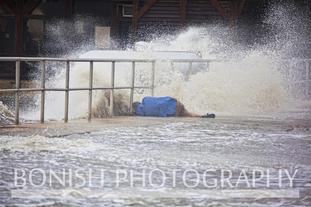 Some Cameramen will go to great lengths to get the shot - Tropical Storm Andrea hits Cedar Key Florida - Photo by Pat Bonish