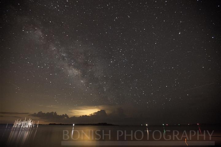 Atsena Otie Key under the stars with a Lightning Storm behind it
