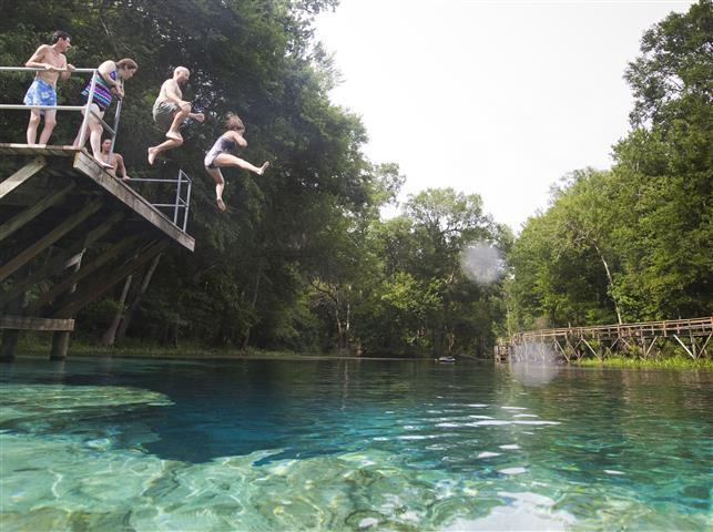 Cindy & Me jumping into Blue Springs - Photo by Jeff Esposito