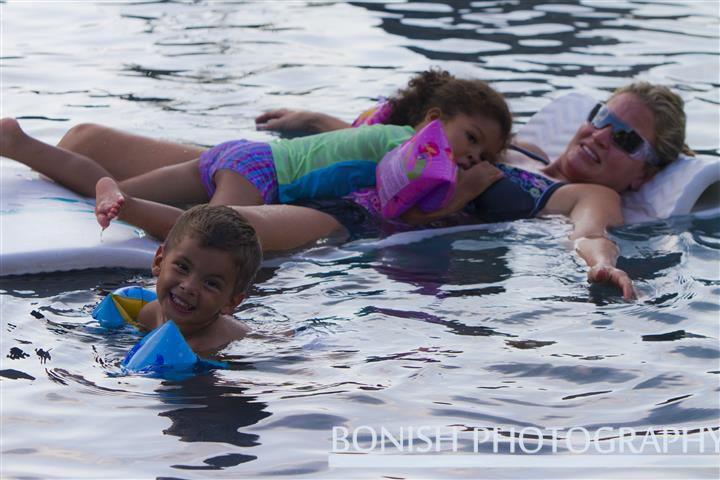 Floating on Oma (Grandma in German - Cindy's heritage) to cool off